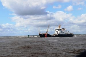 The Coast Guard buoy tender Maria Bray works to reset aids to navigation near Mayport, Fla. Coast Guard photo.
