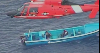 Drug smugglers await a Coast Guard boarding party in the Eastern Pacific Sept. 6. Coast Guard video image.