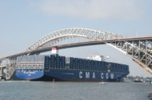 The containership CMA CGM Theodore Roosevelt passes under the newly raised Bayonne Bridge. Kirk Moore photo.