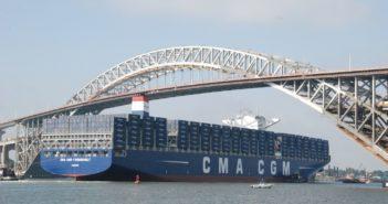 The containership CMA CGM Theodore Roosevelt passes under the newly raised Bayonne Bridge. Kirk Moore photo.