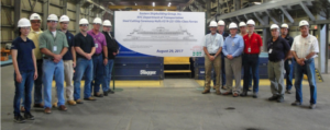 Staten Island Ferry operators, builders and designers at the first steel cutting. ESG photo.
