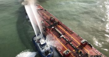 The tugboat Signet Constellation fights a fire on board the B. No. 255 tank barge approximately three miles from the Port Aransas, Texas, jetties on Oct. 20, 2017. Coast Guard photo.