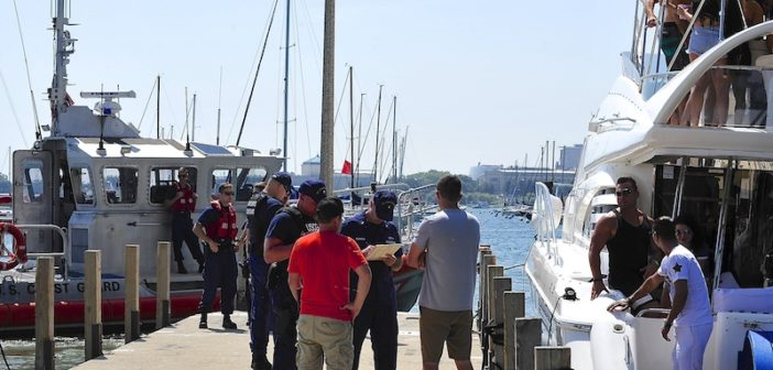 A Coast Guard crew verifies proper documentation during a safety inspection in Chicago in August. U.S. Coast Guard photo by Master Chief Petty Officer Alan Haraf