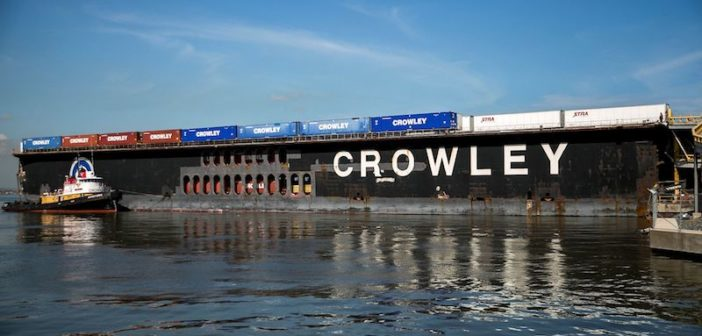 A Crowley barge delivers supplies to Puerto Rico in October 2017. Crowley added six U.S.-flag flat-deck barges to its fleet – a 40% increase in capacity – to help speed deliveries after Hurricane Maria struck Puerto Rico in late September. Photo courtesy Crowley Maritime