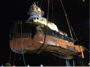 The tug Nathan E. Stewart was recovered by heavy lift crane a month after its October 2016 sinking. Kirby Offshore Marine photo.