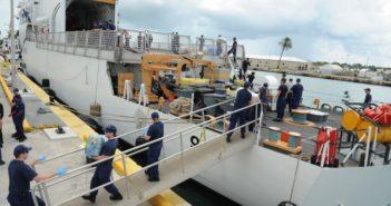 Crew members offload bales of marijuana interdicted during a Caribbean Sea patrol from the Coast Guard Cutter Thetis at Coast Guard Sector Key West, Sept. 11, 2013. Coast Guard photo.