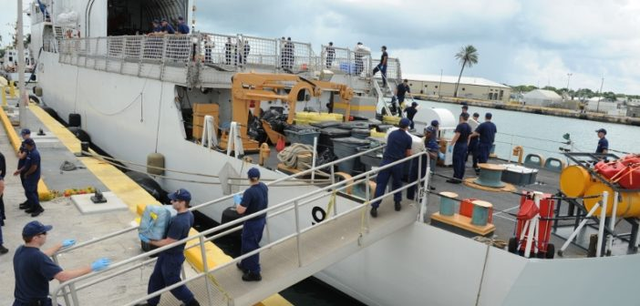 Crew members offload bales of marijuana interdicted during a Caribbean Sea patrol from the Coast Guard Cutter Thetis at Coast Guard Sector Key West, Sept. 11, 2013. Coast Guard photo.
