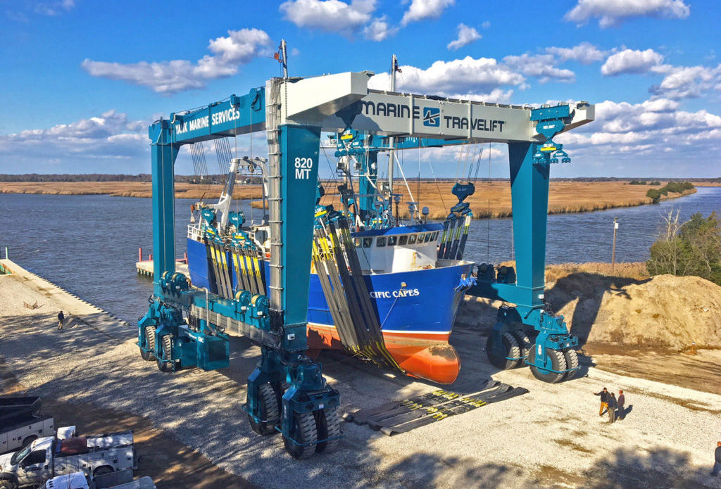 The new 820-metric-ton Marine Travelift at Yank Marine gets its first workout with the fishing vessel Pacific Capes in November. Marine Travelift photo.