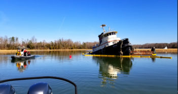A Coast Guard pollution response team from Coast Guard Sector Hampton Roads surveys the area around partially submerged tugboat Bourne on Skiffes Creek, Virginia, Jan. 22, 2018. Coast Guard photo.