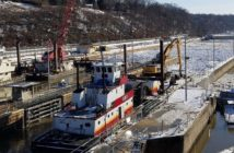 Ice clearing operations enabled barge recovery to begin at the Emsworth Lock and Dam on the Ohio River. Corps of Engineer photo.
