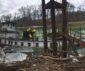 Oil spill cleanup around sunken towboat In West Virginia