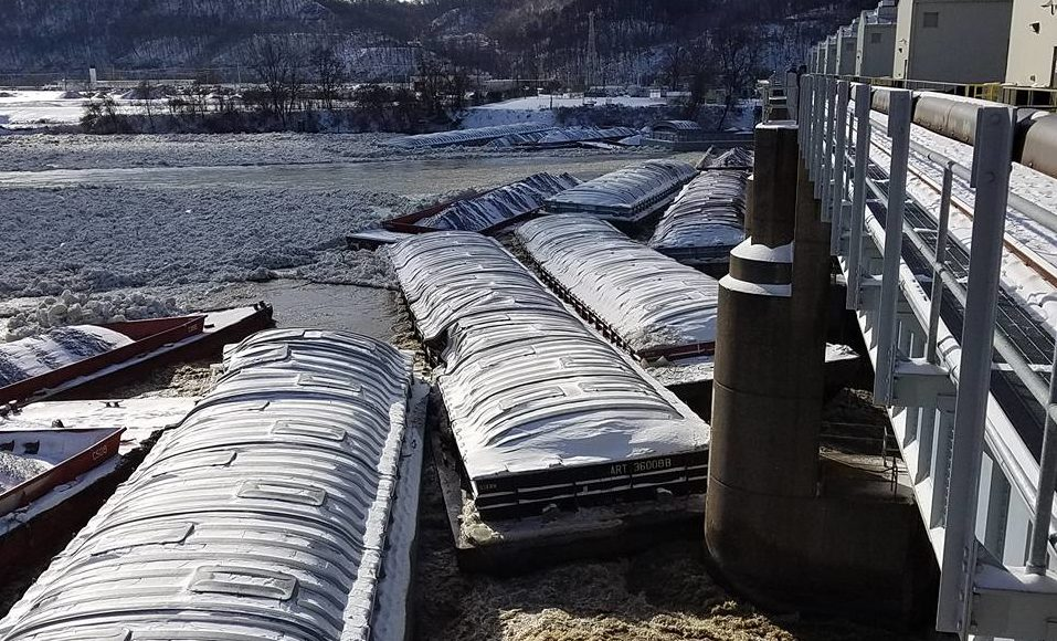 Barges piled up on the Ohio River at the Emsworth Lock and Dam near Pittsburgh, Pa. Corps of Engineers photo.