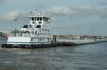 The towboat Angelina pushes a barge on the Mississippi River in New Orleans. Photo by J. Glover
