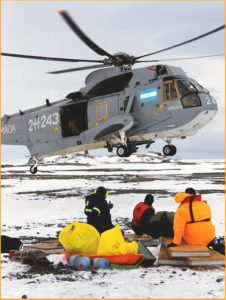 An Argentine Navy helicopter descends to pick up U.S. scientists on Joinville Island in Antarctica. NSF photo.