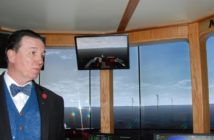 SUNY Maritime professor Eric Johansson show the New York wind farm scenario in the college's bridge simulator. Kirk Moore photo.