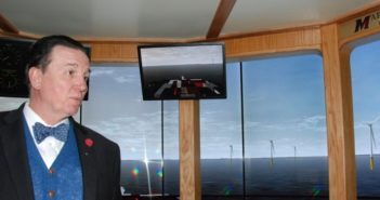 SUNY Maritime professor Eric Johansson show the New York wind farm scenario in the college's bridge simulator. Kirk Moore photo.