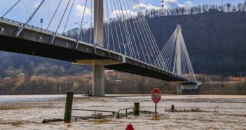 Rising flood waters carry debris down the swollen Ohio River Feb. 19, 2018, in Portsmouth, Ohio. Photo courtesy of Kevin Craft