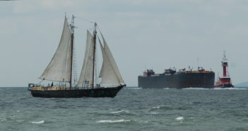 A tugboat with barge and a sailboat in New York Harbor. Betsy Frawley Haggerty photo.