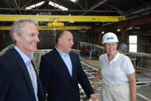 Deepwater Wind CEO Jeff Grybowski with Charles Donadio of Atlantic Wind Transfers, left, and Blount Boast president Marcia Blount during construction of the CTV Atlantic Pioneer in 2015. Kirk Moore photo.