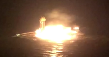 The dredge Jonathon King Boyd burns after striking a natural gas pipeline near Port O'Connor, Texas, April 17, 2018. Coast Guard video image.