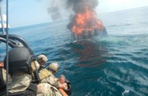 A suspected smuggler, who jumped from his burning vessel, is pulled aboard an interceptor boat from the Cyclone-class coastal patrol ship Zephyr by members of the U.S. Coast Guard and Navy in international waters of the Eastern Pacific Ocean on April 7, 2018. Coast Guard photo/PO1 Mark Barney