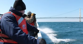 Coast Guard petty officer Brandon McCarty, left, with Matt Kleitch of the Michigan Department of Environmental Quality, searched for wildlife affected by an mineral oil spill in the Straits of Mackinac April 3, 2018. Coast Guard photo/Ensign Pamela Manns.