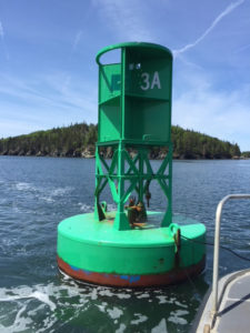 The space in which a sound signaling brass bell hangs on this offshore buoy in Maine is empty after the bell was stolen, off the coast of Maine. Coast Guard photo.