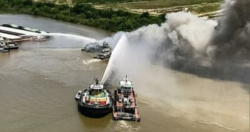 Firefighting teams work to extinguish a barge fire May 6, 2018, on the Mobile River. Mobile Fire-Rescue photo.