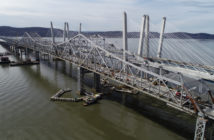 "The Tappan Zee Bridge, decommissioned in October, 2017, is slowly being dismantled. The large ""I Lift NY"" super crane can be seen installing the girders for the last bare gap of the westbound lanes span that will open for traffic later in 2018. Kevin P. Coughlin/Office of Governor Andrew M. Cuomo."