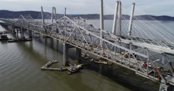 """The Tappan Zee Bridge, decommissioned in October, 2017, is slowly being dismantled. The large """"I Lift NY"""" super crane can be seen installing the girders for the last bare gap of the westbound lanes span that will open for traffic later in 2018. Kevin P. Coughlin/Office of Governor Andrew M. Cuomo."""
