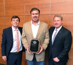 Ben Bordelon, Bollinger president and CEO, accepting award from Davis Gaddy, SCA government relations coordinator (left) and Matthew Paxton, SCA president. Bollinger Shipyards photo