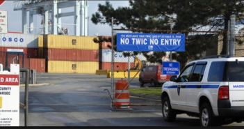 A sign notified port workers, longshoremen and truckers at Conley Terminal in Massachusetts of the Oct. 15, 2008 deadline for obtaining a Transportation Worker Identification Credential (TWIC). USCG photo.