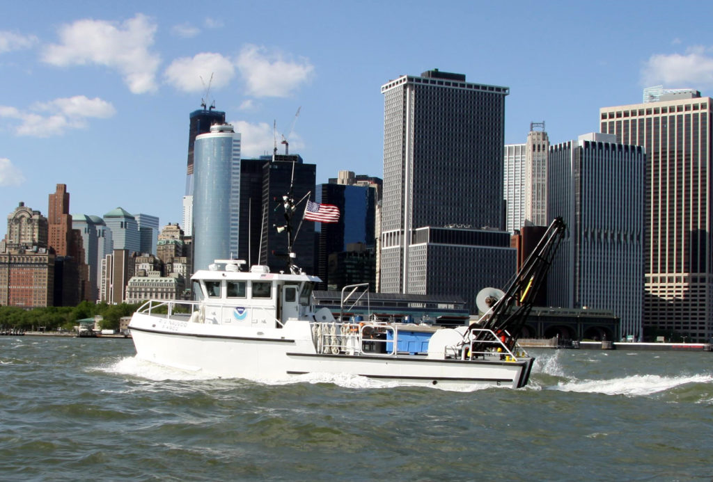 The research vessel Nauvoo in the colors she wore during service with the National Oceanic and Atmospheric Administration. NOAA photo.