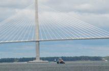 Tugs pass the Arthur Ravenel Jr. Bridge on the Cooper River at Charleston, S.C. Kirk Moore photo