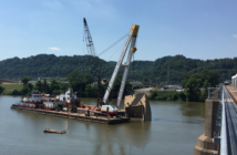 The River Salvage Co. barge Big Al works to remove a section of a barge that sank at the Emsworth Locks and Dams on the Ohio River in Ianuary 2018. Corps of Engineers Pittsburgh District/Thomas Bayle photo