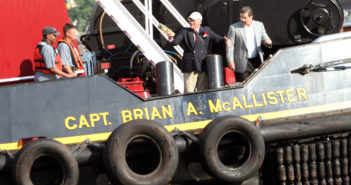 Capt. Brian A. McAllister swings the champagne bottle to christen his namesake tractor tug on July 12, 2018, in New York. Photo courtesy McAllister Towing