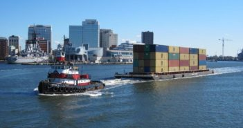 A tug moving containers by barge. SUNY Maritime photo.