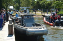 People at this year's MACC line the dock for a chance to climb aboard one of the patrol boats at the conference. Ken Hocke photo