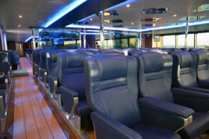 The main deck aft cabin seats 214 passengers and includes a dedicated child-friendly area as well as a refreshment bar. The forward end of the vessel's main deck features a premium class area with 64 seats. Incat Crowther photo