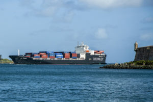 The ship has a cruising speed of 22 knots and can carry about 2,400 TEUs . Crowley Maritime photo