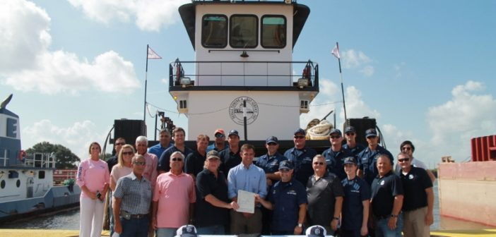 The Coast Guard Marine Safety Unit Lake Charles presented Devall Towing & Boat Service with a certificate of inspection for the pushboat Capt Al Devall Aug. 15, 2018. Coast Guard photo.