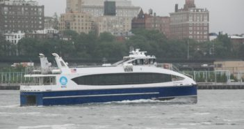 The ferry Ocean Queen Rockstar heads for Rockaway after pulling away from Pier 11 in New York's East River. Kirk Moore photo.