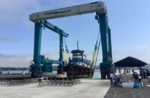 Workers prepared for the dedication of a new 330-ton Marine Travelift boat hoist at the Portland Shipyard in Maine Aug. 14, 2018. Portland Shipyard photo.