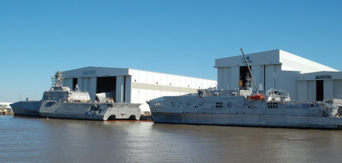 Littoral combat ship (left) and expeditionary fast transport (right) at Austal USA in Mobile, Ala. Ken Hocke photo