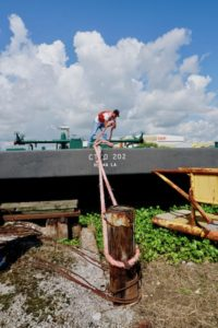 Raymon Callais, tankerman course student, practices his barge tying skills. Cenac Marine photo