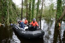 Coast Guard personnel rescue an elderly woman and her husband along with their pets after their home was flooded by Hurricane Florence, in Brunswick County, N.C., on Sept. 16. Coast Guard photo/PO3 Trevor Lilburn.