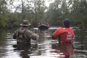 Members of Coast Guard Maritime Safety and Security Team Miami and Coast Guard Tactical Law Enforcement Team South wait to be picked up by their rescue team after completing Hurricane Florence search and rescue operations in Brunswick County, North Carolina, Sept. 16, 2018. Coast Guard photo/PO3 Trevor Lilburn.