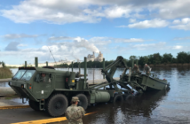 Soldiers with the South Carolina National Guard 125th Multi-Role Bridge Company launch a boat to prepare bridge crossings where the flooding Waccamaw and Great Peed Dee rivers converge in Winyah Bay, S.C. Photo courtesy Georgetown County, S.C.
