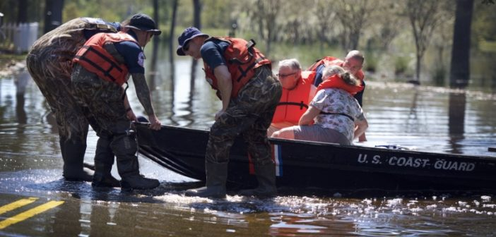 Members of the Coast Guard Gulf Strike Team rescue an elderly couple after floodwaters from the Waccamaw River took over their apartment complex in Horry County, South Carolina, Sept. 19, 2018. Coast Guard photo/PO1 Jon-Paul Rios.