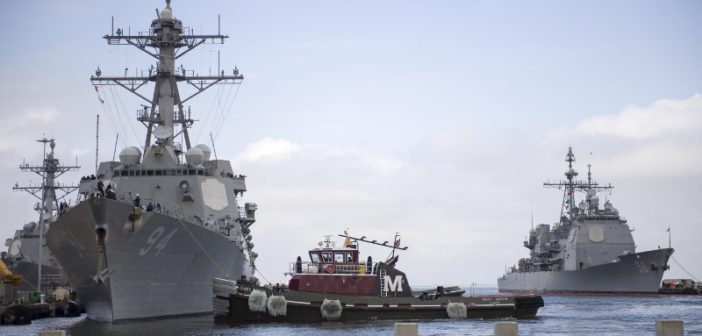 The tug Tracy Moran assists the Navy guided missile destroyer Nitze as its crew prepares to sortie into the open Atlantic ahead of hurricane Florence Sept. 10, 2018. Navy photo/Spc. 2 Justin Wolpert.